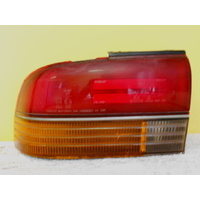 MITSUBISHI MAGNA TR/TS - 4DR SED 6/9>10/95 - PASSENGERS - LEFT SIDE - TAIL LIGHT (Genuine)