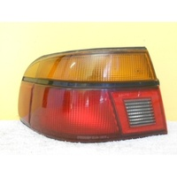 FORD LASER KF/KH - 3/1990 to 10/1994 - 5DR HATCH - LEFT SIDE TAIL LIGHT - STANLEY 04-1311(Genuine)