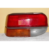 FORD LASER KC - 10/1985 to 3/1990 - 5DR HATCH - PASSENGERS - LEFT SIDE TAIL LIGHT (GENUINE)