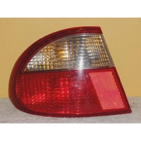 DAEWOO LANOS SE - 9/1997 to 10/2003 - 4DR SEDAN - PASSENGERS - LEFT SIDE TAIL-LIGHT - HEUNG 03-4616