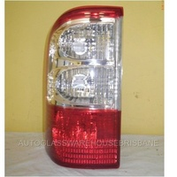 NISSAN PATROL GU 1/2 - 10/2001 TO 9/2004 - 4DR WAGON - LEFT SIDE TAIL LIGHT - CLEAR/RED